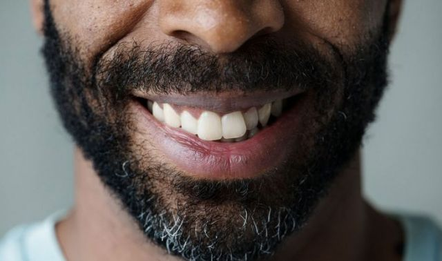 Closeup of african american man with beard, smiling